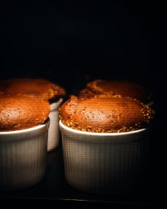 brown and white cupcakes on white ceramic cup